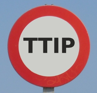 anti Transatlantic Trade and Investment Partnership sign in Brussels